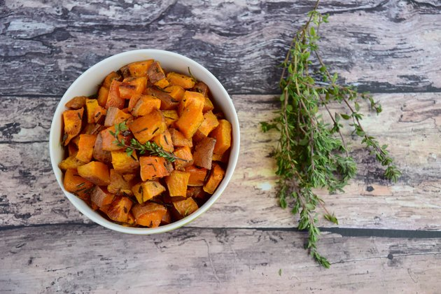 Bowl of roasted cubed sweet potato with thyme