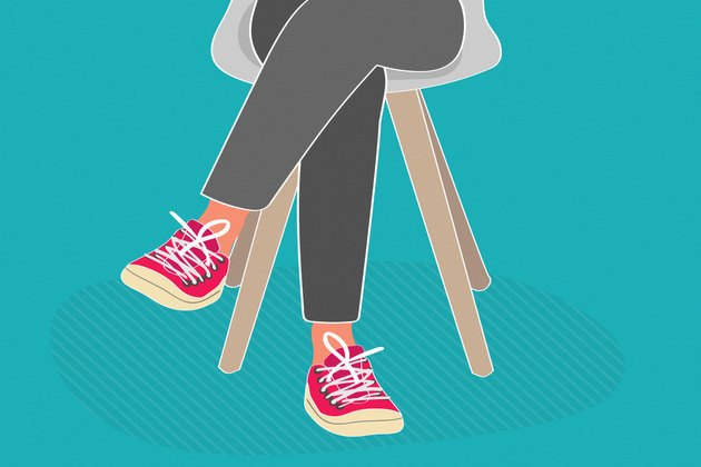 illustration of person's lower body with legs crossed wearing red sneakers on teal background