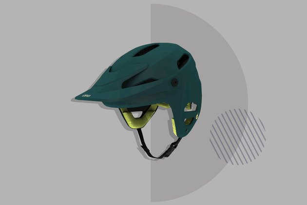 green Giro Tyrant Spherical Helmet on gray background