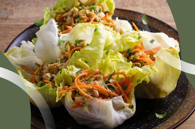 Turkey Lettuce Wraps with shredded carrots on a dark plate