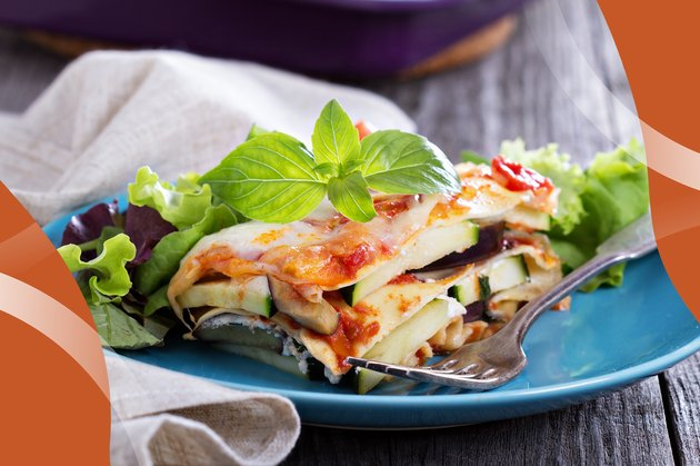 Lean Lasagna on blue plate with a fork on a wooden table