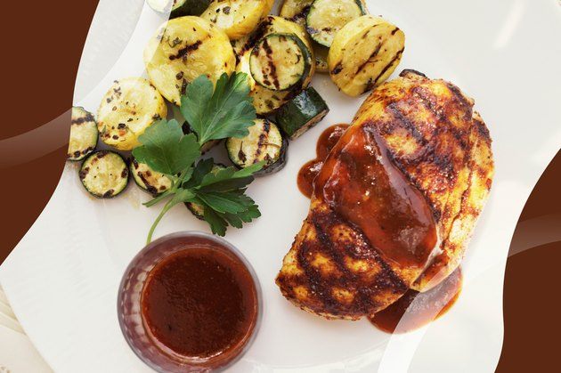Easy Grilled Chicken Mole Poblano with squash rounds on a white plate