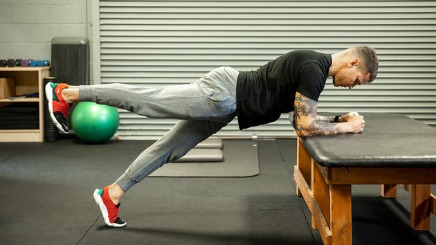 Move 5: Elevated Plank With Alternating Leg Lift