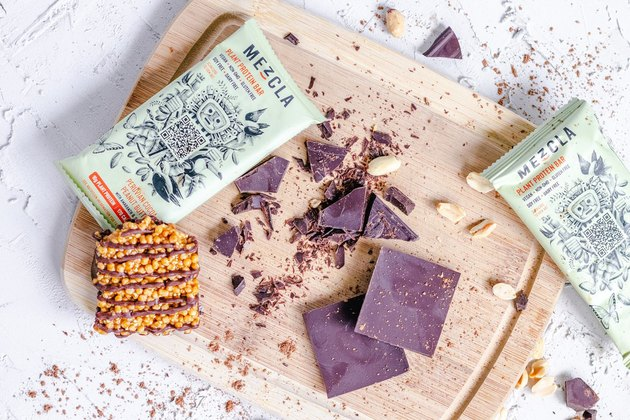 Mezcla protein bar on wooden board with chocolate