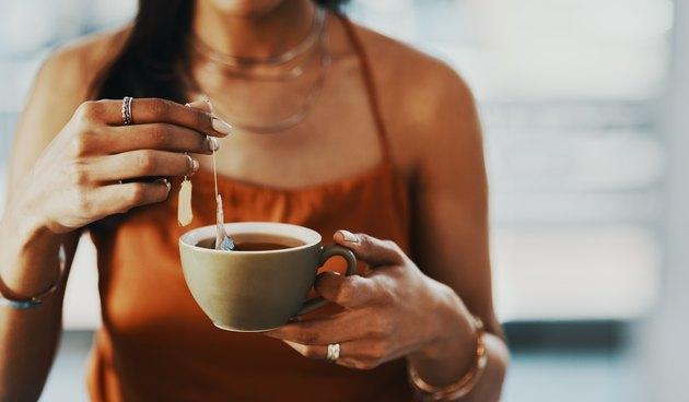 Woman steeping tea