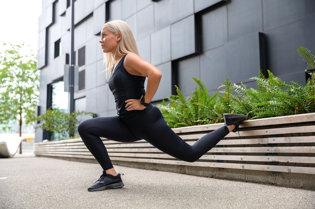 Woman doing lunges outside to fix glute imbalance
