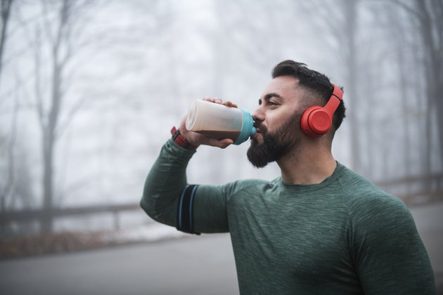 Man Drinking a Low-Carb Protein Shake After Exercising Outdoors