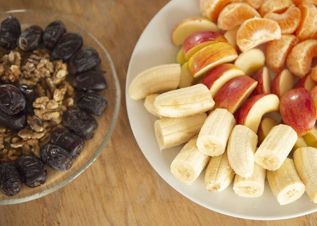 Mixed fruit and nuts on a table.