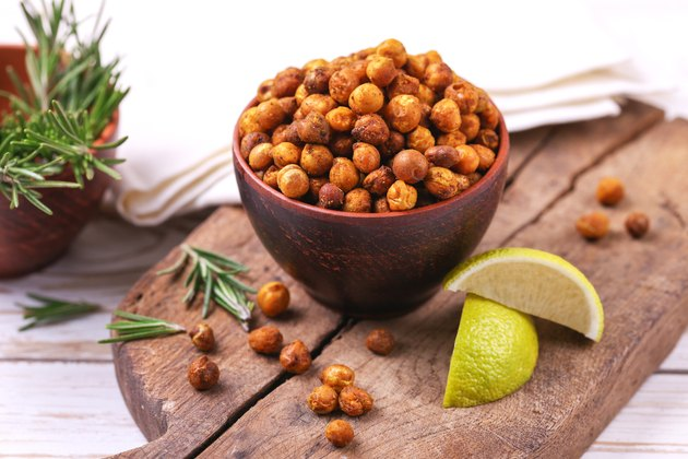 Roasted chickpeas in bowl with lime and rosemary