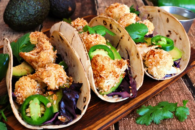 Healthy coconut cauliflower tacos, close up on wood