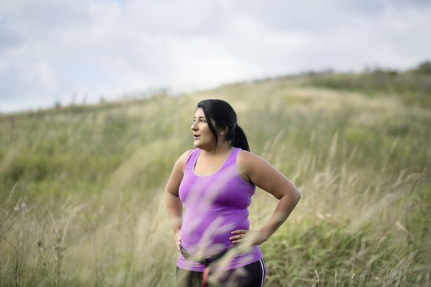 woman with chronic fatigue syndrome resting while exercising outside