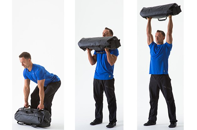 Man doing a Sandbag Clean and Press sandbag exercise