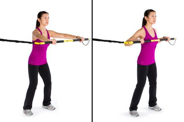 Woman performing rip lunge press TRX exercise