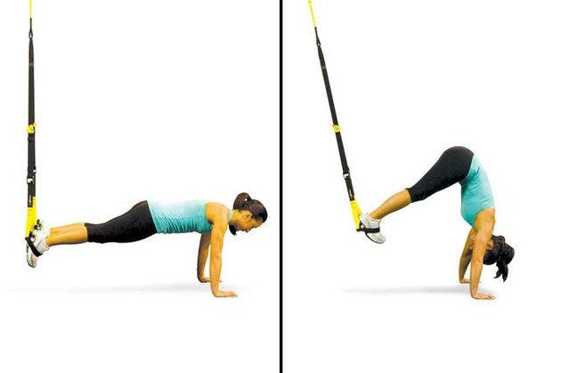 Woman performing TRX pike.