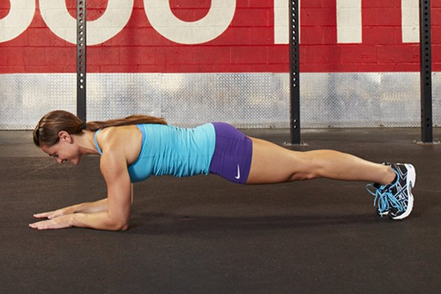 Woman performing plank exercise.