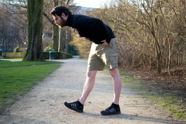 Man performing heel-toe walks before a bike ride