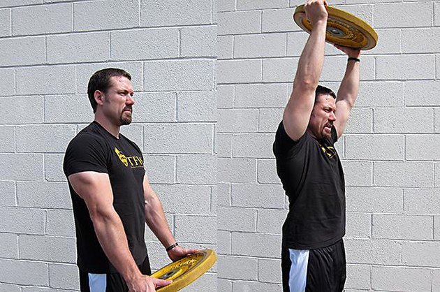 Man performing front plate raise.