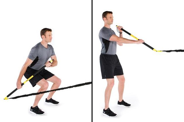 Man performing rip paddleboard row TRX exercise