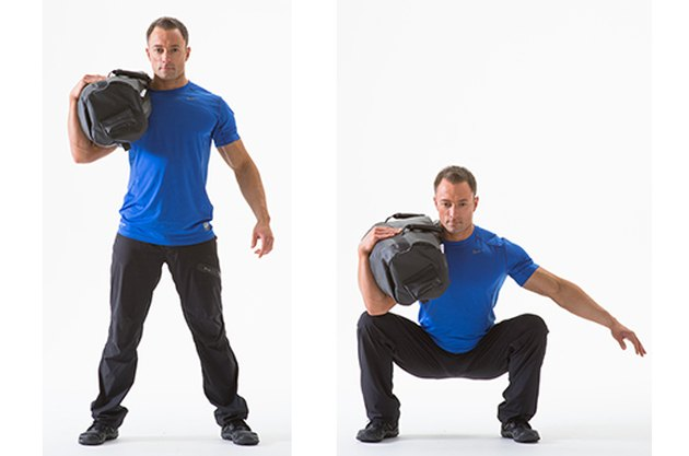 Man doing a Sandbag Squat sandbag exercise