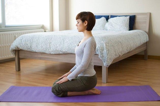 Woman demonstrating how to do Hero pose yoga for sleep