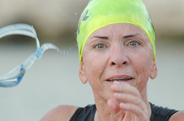 Triathlete poses for photo during race