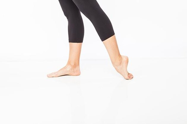 Woman demonstrating top of the foot stretch