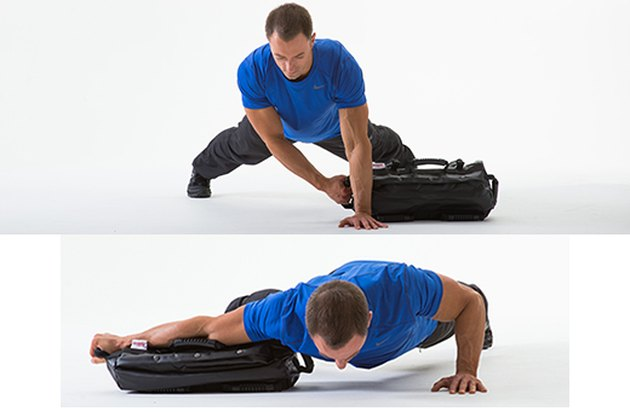 Man doing a Lateral Sandbag Drag With Push-Up sandbag exercise