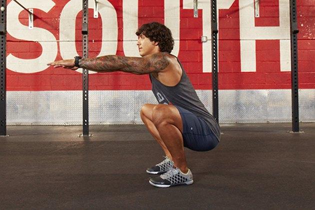 Man performing CrossFit body-weight air squat.