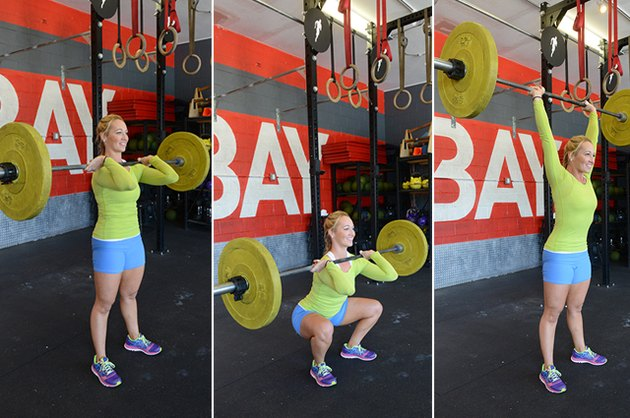 Woman performing thruster exercise.