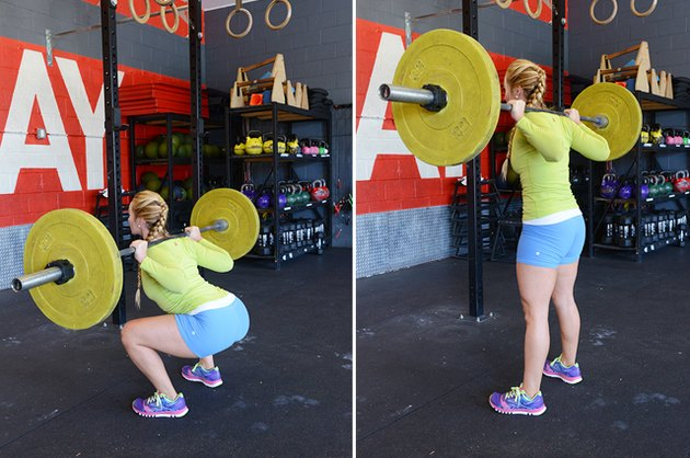 Woman performing back squat.