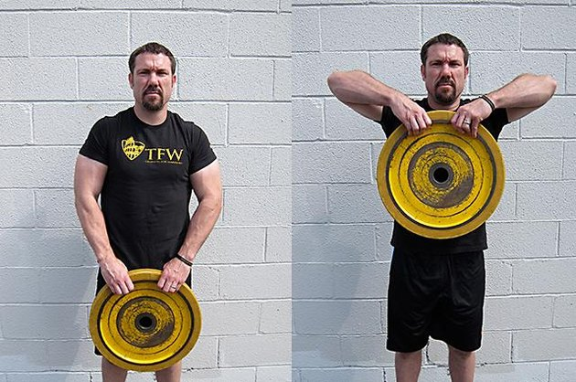 Man performing plate high pull.