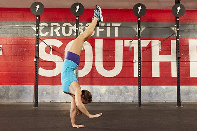 Woman performing handstand walks.