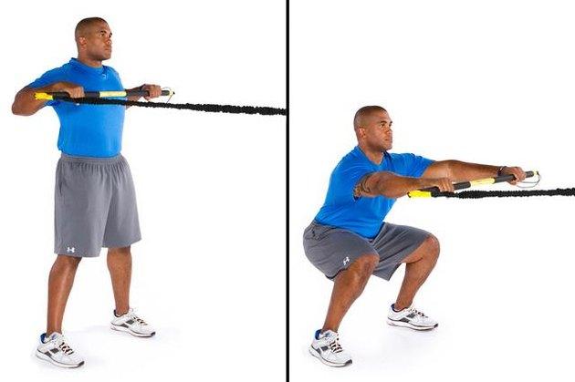 Man performing rip squat row TRX exercise