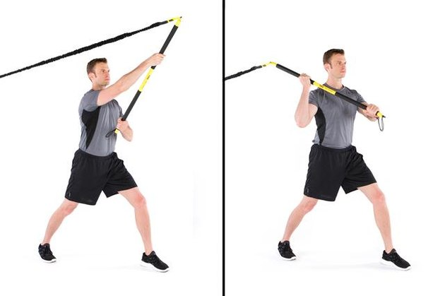 Man performing rip overhead axe chop TRX exercise