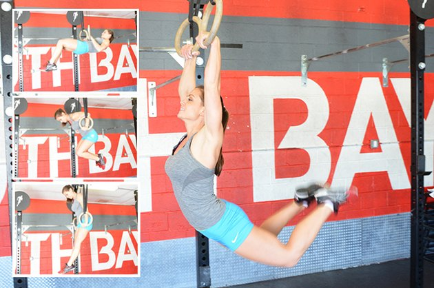 Woman performing muscle-up.