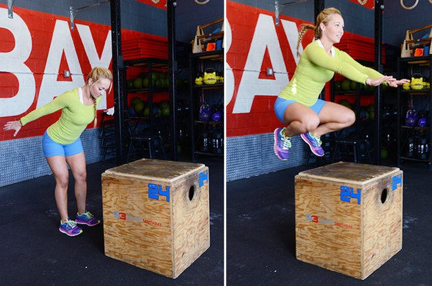 Woman performing box jump.