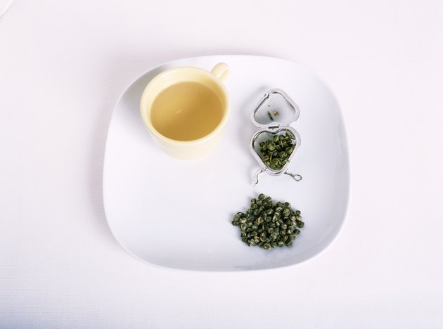 tray of herbal tea on white
