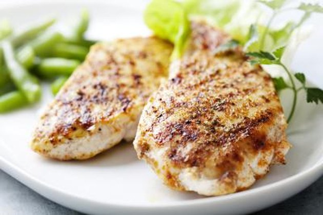 seasoned grilled chicken breast on plate