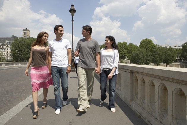France, Paris, two couples crossing bridge