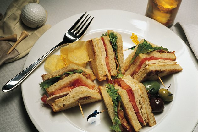 Clubhouse sandwich with golf ball and tee