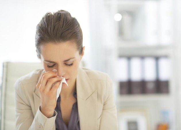A young businesswoman, allergies