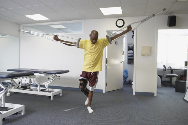 Patient standing on his one leg holding a crutch
