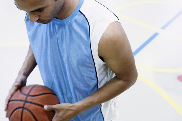 High angle view of a young man holding a basketball