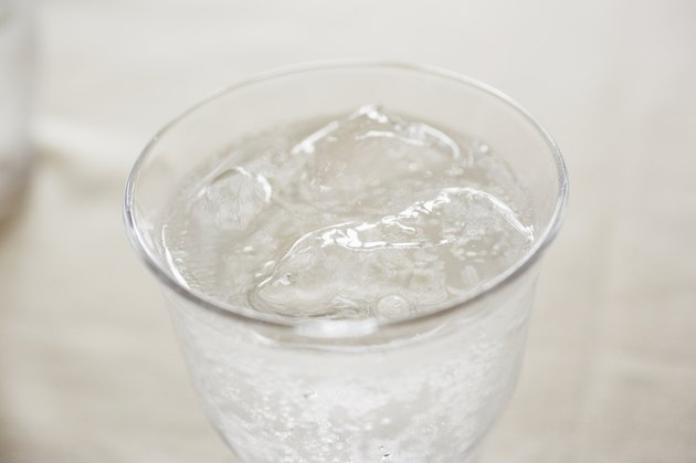 Glass of soda on table, close up
