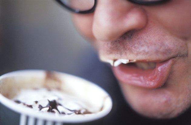 Man Drinking a Creamy Coffee Drink