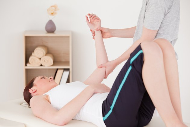 Young woman having an arm massage
