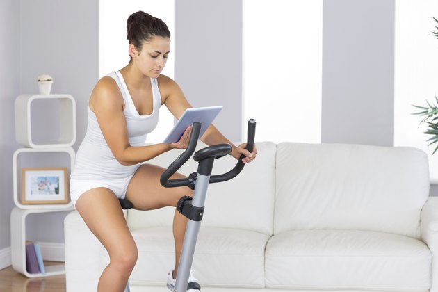 Young woman training on exercise bike
