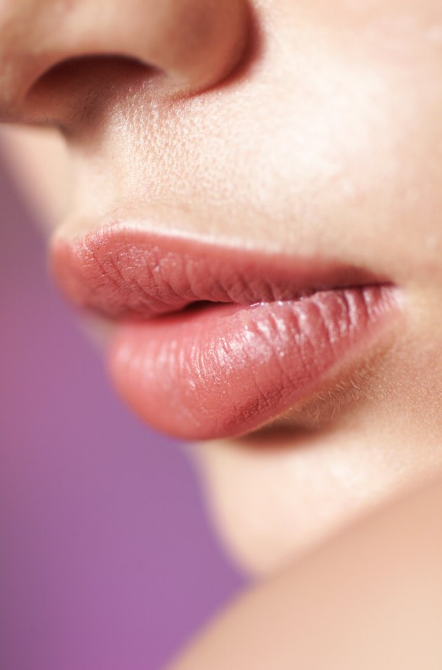 a close up shot of the full lips of a young caucasian girl