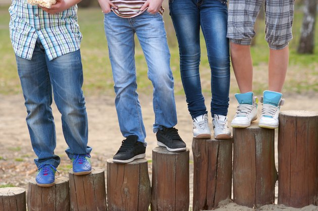 Legs and sneakers of teenagers