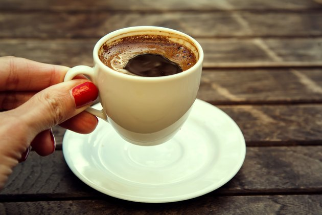 "woman's hand holding cup of Turkish coffee ""espresso"" Istanbul, Turkey"